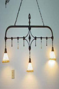 chandelier made from an antique bed frame