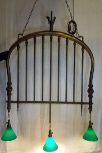 repurposed brass bed frame chandelier with swan hook
