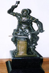 Brass blacksmith statue